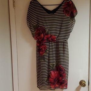 En focus striped dress with large rose print.